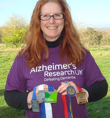 Susie with her five 2012 marathon medals