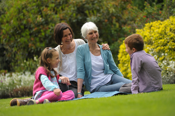 A family sitting in a park
