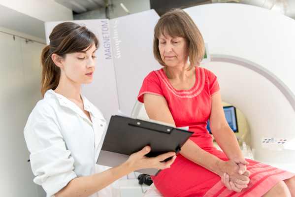 A doctor explaining a patient's MRI scan results