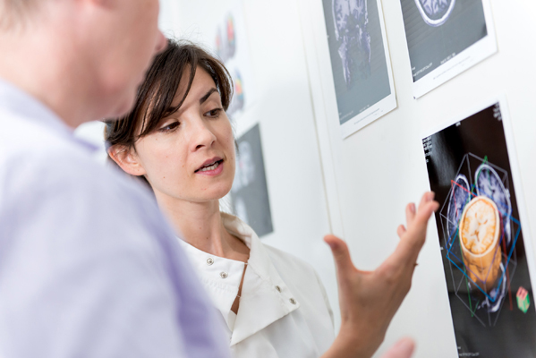 A scientist explaining an MRI scan to a patient