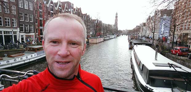 Chris Wright on a bridge in Amsterdam