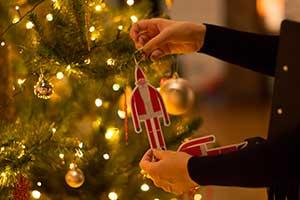 putting-santa-on-tree