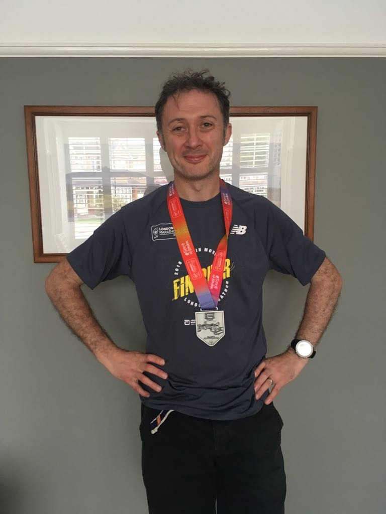 Clinton page standing with medal