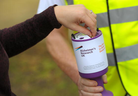 Making a donation in a collection box