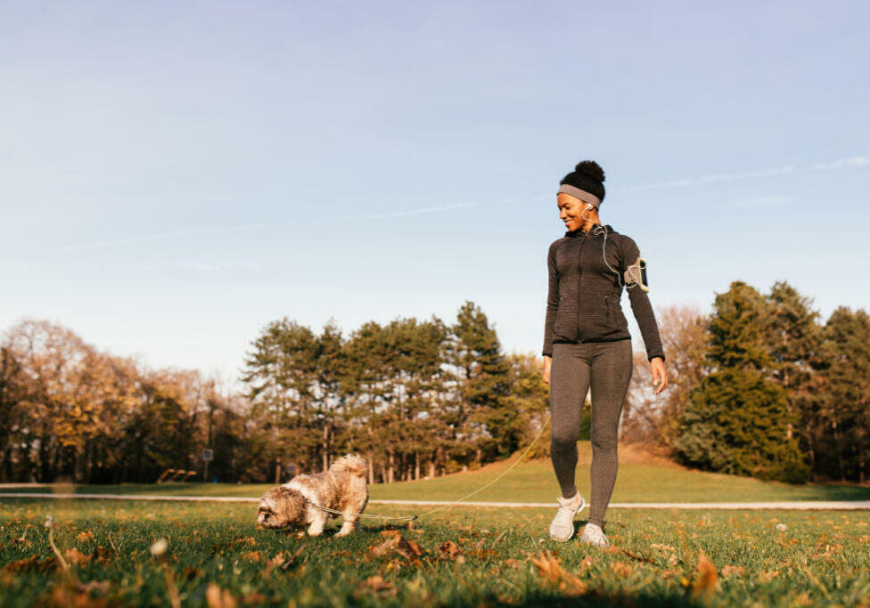 Happy,African,American,Athletic,Woman,Enjoying,While,Walking,Her,Dog