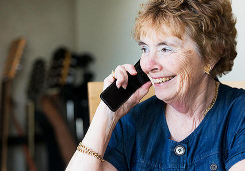 An Alzheimer's Research UK volunteer talking on the telephone